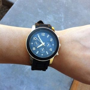 Brand new black rubber banded watch